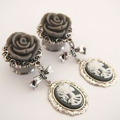 9/16 inch 14mm Grey Lady Death Double Flared Steel Dangle Plugs for... ($5) ❤ liked on Polyvore