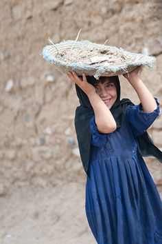 https://flic.kr/p/9XGxcB | Portrait from Pakistan | This picture was taken in Islamabad. This girl is helping her family constructing the house. The community living in the locality are very poor migrant workers from northern area. The locality has no basic amenities like water, sanitation etc.