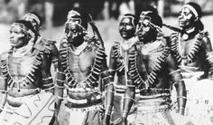 Kenyan warriors of the Kikuyu tribe assemble, dressed in ceremonial costume.
