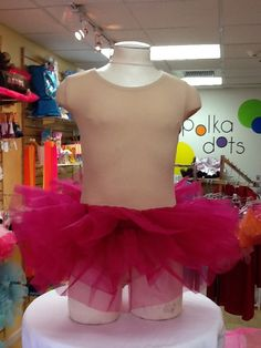 Organdy Tutu in Raspberry $12.50. One Size Fits Most. For more information or to check availability, call or email Polka Dots. 916-791-4496. polkadotsproshop@gmail.com