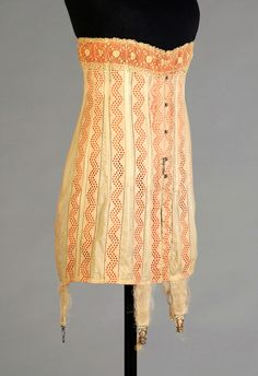 Corset of cotton eyelet over orange ribbons American, 1914, KSUM 1983.3.52.  For more about this corset, check out the post about it that our Curatorial Assistant, Joanne Arnett, wrote on her blog: http://goo.gl/8waK1x
