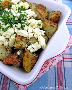 Greek style baked potatoes aka fries with feta cheese - the part of tossing with feta on the pan after baking the potatoes made the difference - good one