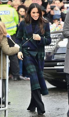 Markle wore a Burberry coat and Veronica Beard trousers while visiting Edinburgh Castle during the couple's first official joint visit to Scotland.