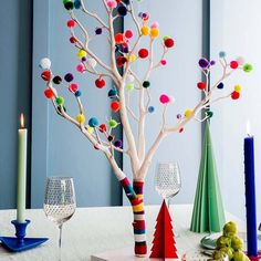 Use this pom pom Christmas tree as a centre piece on a Christmas table. It's an eye-catching piece and full of colour. Alternatively, if you haven't got space for a full size Christmas tree, and want something a bit different, this could fit the bill perfectly. #alternativeChristmas #bohoChristmas #bohoxmas #christmastree #christmascolour #colourpop #freshdesign