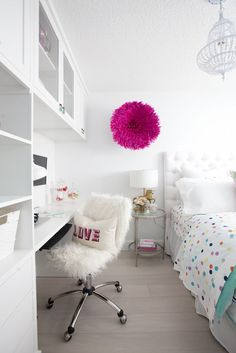white clean bedroom with pops of color