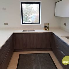 Installed We installed the Attica White Carrera Quartz today in this kitchen in St Albans. A contemporary wood grain kitchen now featuring it's Rock & Co worktop! St Albans, Carrara, Wood Grain, Granite, Saints, Contemporary