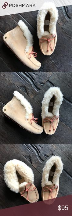 UGG ALENA SLIPPERS MOCCASINS MOCS BOOTS SZ 6 Worn 1 time indoors.  No flaws or sign of wear.  These are perfect.  Sand and pink bow and bottoms. You will want to live in this slipper. This bestselling style (and Oprah favorite) features soft suede, plush natural wool, and a rubber outsole that can handle outdoor wear. Styled with a sweet bow and decorative moccasin stitching, the Alena also has a foldable collar for versatility.   Leave it up or fold it down.  See pics. UGG Shoes Slippers