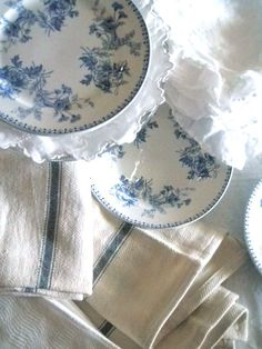 Delicate vintage patterned blue and white dishes coupled with authentic French linen dish towels.