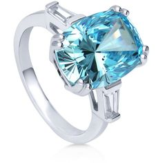 BERRICLE Sterling Silver Oval Cut Blue CZ Solitaire Fashion Right Hand... ($57) ❤ liked on Polyvore featuring jewelry, rings, blue, women's accessories, blue cubic zirconia ring, sterling silver rings, cubic zirconia band rings, sterling silver cocktail rings and cz cocktail rings