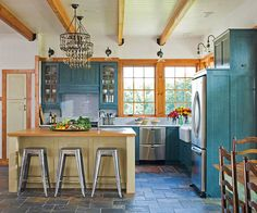 LOVE THE COLOR OF THESE CABINETS!    Give a kitchen a rustic vibe with wood and metal accents. See our picks here: http://www.bhg.com/decorating/decorating-photos/kitchen/humble-beginnings/?socsrc=bhgpin020813bluekitchen