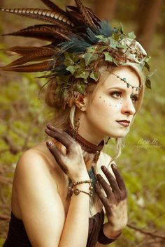 Woodland fae ~ love the feather and vine headdress, face makeup and 'dirty hands' | via Facebook by BeaB Photographie