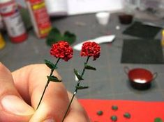 1 inch minis: Geraniums made of paper and rusty pail m/o cardstock