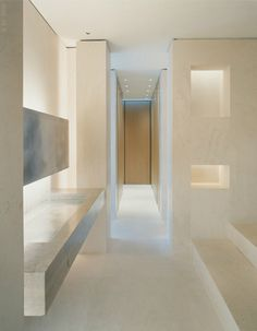 Make an Entrance. Minimalist limestone walls and floors. Architect & Interior Designer: Sam Trimble.