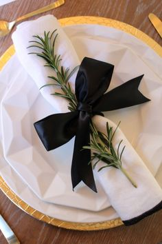 Rosemary makes everything look nice... not obviously this ugly black bow-- but still like the idea, especially with a winter wedding