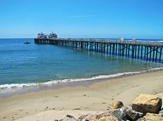 The Malibu Pier surrounded by beach blues.