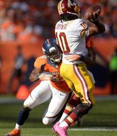 Jackets In The Pros: #59 Danny Trevathan, Denver Broncos, Washington Redskins quarterback Robert Griffin III (10) is hit by Denver Broncos outside linebacker Danny Trevathan (59) in the second quarter. (Photo by Joe Amon/The Denver Post)