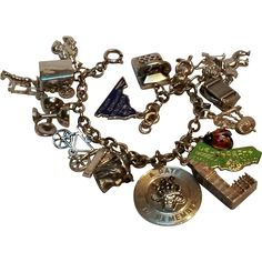 Sterling bracelet sixteen charms enamel ladybug, state, phone, imp, from…