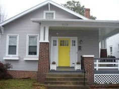 yellow front door by pullpusher, via Flickr