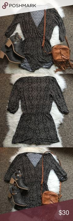 Iris tribal print romper Brown tribal button front jumper. First picture is unbuttoned, third is buttoned. Quarter sleeves. Super cute and comfy! Iris Los Angeles Pants Jumpsuits & Rompers