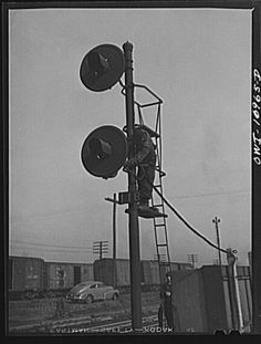 Repairing signals at an Indiana Harbor Belt Line railroad yard, ca. 1940.