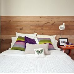 A simple pallet wall headboard DIY transforms this Happy Space Project guest room from bland to beautiful