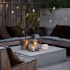 Stylish festoon lights from Danish company House Doctor. Add these stylish LED lights to a yard or back garden for instant feature lighting. The modern concrete and wood really works in this photo. Glass votives, tealights, metal plantpots and fabrics all Backyard Seating, Garden Seating, Backyard Patio, Contemporary Garden Rooms, Modern Garden Design, Modern Design, House Doctor, Garden Furniture, Outdoor Furniture Sets