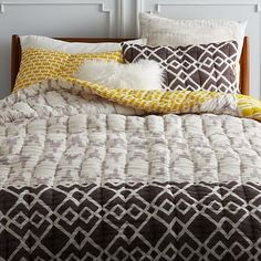 Hand-Blocked Oval Ikat Quilt + Shams  | Skilled Indian artisans use a traditional wood block print technique to create the bold pattern of this light and lofty cotton quilt. Because the pattern is created by hand, no two quilts are alike.