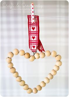 Wooden Bead Heart - by Craft & Creativity. What a simple idea for Christmas or Valentine's Day. What are you waiting for! Get crafting and stop by www.fizzypops.com for your supplies!