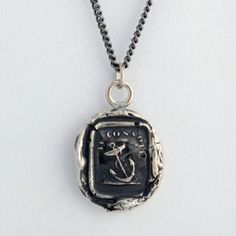 Peace of Mind Talisman Necklace....This handcrafted wax seal necklace reads Je Console, which means I Comfort. Anchors, which are used to keep vessels from going adrift in strong wind or current, represent stability and peace of mind.