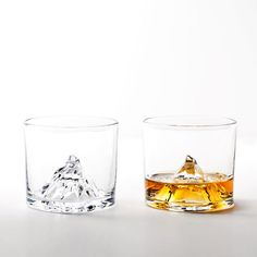 """Matterhorn is a spectacular mountain that stands tall on the border between Switzerland and Italy. It's the sort of thing you'd see on a postcard or a souvenir, but we've got something more impressive. This crystal glass features its own replica of the Matterhorn right in the middle of the glass, giving the phrase """"drink on the rocks"""" a whole new meaning."""