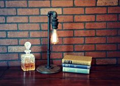 This industrial chic table lamp will add style to any room in your home or office with a classic industrial look that is very clean and versatile.