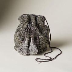 [Picked from SUNDANCE] Gemini Drawstring Bag: A dazzling delight with allover, Art Deco-style beading and tasseled drawstrings, this diminutive bag is the perfect accessory for a night on the town. Polyester with nylon drawstring. Potli Bags, Stylish Handbags, Wedding Bag, Boho Bags, Embroidered Bag, Girls Bags, Pouch Bag, Handmade Bags, Evening Bags