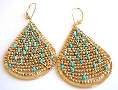 Wire Wrapped Earrings made up of 14k gold fill balls and Arizona turquoise