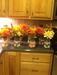 Quart Mason Jars wrapped with burlap! Fantastic fall table centerpiece! Its E A S Y too!