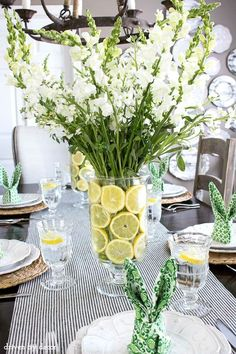 Simple floral centerpiece with lemon slices lining the vase - perfect for a spring table!