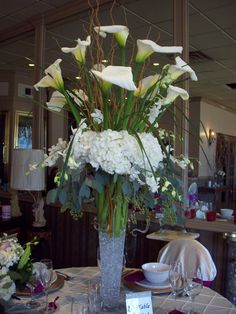 Callas, hydrangeas and orchids. Open with a natural flow. Distinctive Floral Design Mineola, NY 516.742.4800