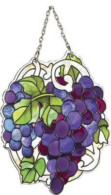 Grape Cluster Sun Catcher . $11.95. 3.5 x 4.5 inches. Wine theme accent. Made of glass. The fruits of the vine make for a fascinating theme in many home décor accents, so it's little wonder that this grape cluster sun catcher is so popular.  Whether you have a Tuscan themed dining room, or have just created a wine bar in a corner of the family room, the rich purples and blues that flow from this piece make the perfect accent.  Present one to your favorite wine lover with a bott...