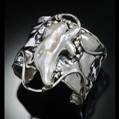 Shall We Dance!    Fancy freshwater pearl in hand fabricated/forged sterling silver. sold