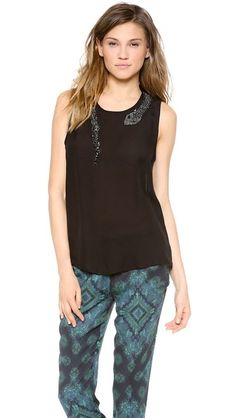 Without the snake, this is just a black tank.  It is all in the details. Haute Hippie Muscle Tank with Beaded Snake | Pretty Little Liars