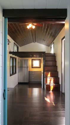 240 square feet tiny house on wheels designed and built by Brevard Tiny House in Brevard, North Carolina. Cool sunken kitchen and open living area with two lofts! Tiny House Swoon, Tiny House Living, Tiny House Plans, Tiny House Design, Bus Living, Tiny House On Wheels Stairs, Tiny House With Loft, Loft House, House Stairs