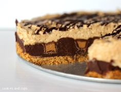 Reese's Fudge Pie via Cookies and Cups- How does this sound? Graham Cracker Crust, a layer of fudge with peanut butter cups pushed into it, a peanut butter mousse layer, and to top it of, a chocolate drizzle. Yum!