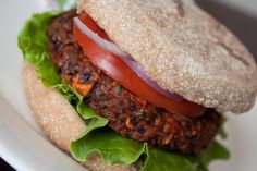 Vegan Black Bean Burgers - loaded with bell peppers, onions, mushrooms, and carrots! These are so flavorful and filling, even meat eaters love them! #vegan #burgers #vegetarian