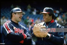 Reggie Jackson and Rod Carew of the California Angels share a laugh prior to a 1983 season fame. Get premium, high resolution news photos at Getty Images Baseball Wall, Angels Baseball, Reggie Jackson, America's Pastime, Baseball Pictures, The Outfield, American League, Baseball Players, Mlb