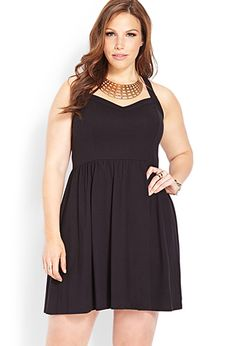 I got this dress about two weeks ago, and I love it!!!  It fits great, no cami needed!  Just throw a cardigan over and your done!!!  LOVE IT!!!   Effortless V-Neck Dress | FOREVER21 PLUS