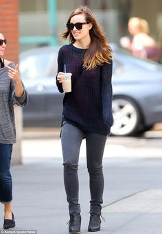 Slim mama: Olivia Wilde, who gave birth to her son Otis in April, stepped out in New York City on Tuesday looking skinny post-pregnancy in tight jeans as she sipped a cool beverage
