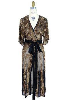 We wanted to combine the decadent dressing gowns of the 1930's with the iconic 1970's Deco wrap dress. Voila...our Femme Fatale Wrap Dress! Covered with hand-a