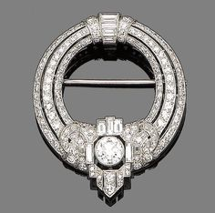 An art deco diamond brooch, circa 1930  The openwork circlet pierced and set with three tapered rows of single-cut diamonds, to a central cartouche set with similarly and baguette-cut diamonds collet-set at the centre with a larger old brilliant-cut diamond, diamonds approx. 2.85ct total