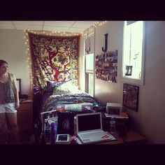 I like the idea of a tapestry/fabric type hanging on the wall