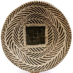 These African baskets are woven in Zambia and Zimbabwe from wild grasses and palm leaves. Beautiful as a wall display, traditionally these are winnowing baskets.