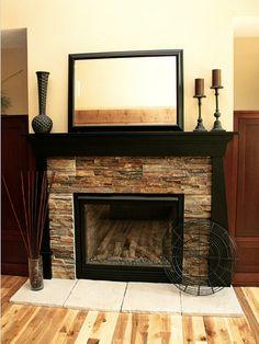 Stacked stone & travertine surround this fireplace